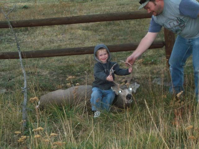 2003 Muzzle loader 3x2 Mule deer With 1 day remaining before I had to leave to go antelope hunting in Wyoming, I had my 3yr old boy and wife with me when we spotted this buck feeding along with 30 other deer. My boy was hoping up and down yelling