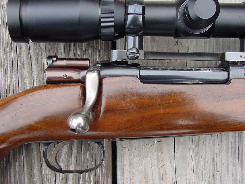Click to view full size image  ==============  Model 96 Swede Right Side of Action Close These are the modifications to the bolt as mentioned. Note the removal of the cocking knob at the rear of the bolt, the new scope safety, flat bolt handle, shaped knob and the angle that the bolt is swept back. The Timney trigger has been shortened and the tip rounded. In the photo you can also see that the rounded ridge behind the stripper clip opeaning has been removed. The bolt body has been polished to 500 grit and jewled or engine turned. The extractor has been blued but should be left polished as it will scratch when the bolt is worked.