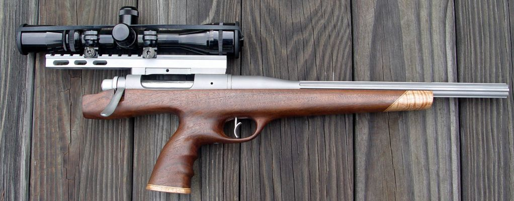 Click to view full size image  ==============  XP-100 in 6.5 BR This is a 6.5 BR that I built. The action has been altered, a spoon bolt handle added. The barrel is a Sheilen ultra match SS 1-8 twist. Stock is walnut with maple tip and cap. Trigger is a Taylor 4 oz. Scope mount is custom, extended mount. Scope is a 3x12 Burris Signature. The gun was built to shoot 1/2 size targets and 500 meter silhouette.