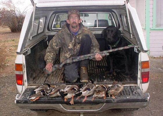 2004 Duck Hunt My dog Molly and I had a good days hunt.Shotgun is a Mossberg 835 Ulti-Mag which I painted Myself.