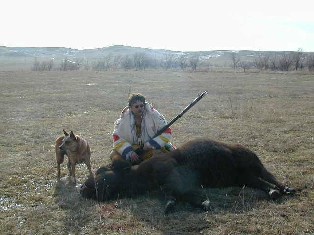 My first Buffalo with 50 caliber black powder This was a great hunt. I went to this hunt to help some friends and found out there was one extra buffalo avalible. Wasn't sure I could afford it, but it was a buffalo hunt, had to do it. Got 405 pounds of meat off of this one. Great eating.