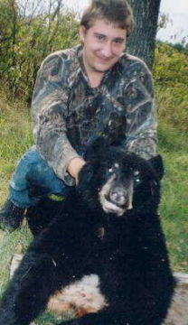 Dan JR 1st bear... Wounded bear that attacked while tracking. 2 shots from JR's 12 Ga. shotgun stopped him at point blank.
