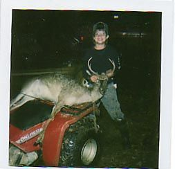 My oldest son with his first deer