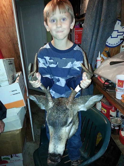 sam with 2014 buck.jpg